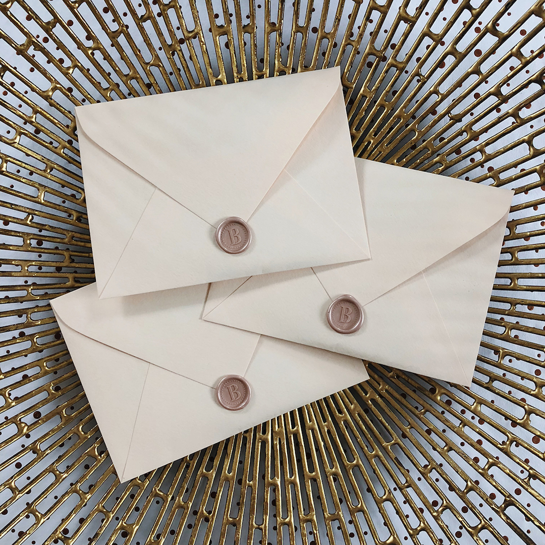 3_stacked_envelopes_bronze_backgroubd.jpg