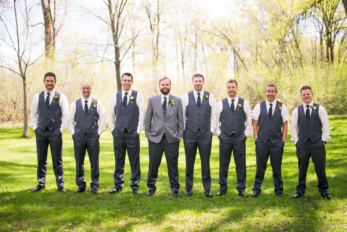 7_groomsmen_dark_gray_tuxes_green_boutineers_black_shoes.jpg