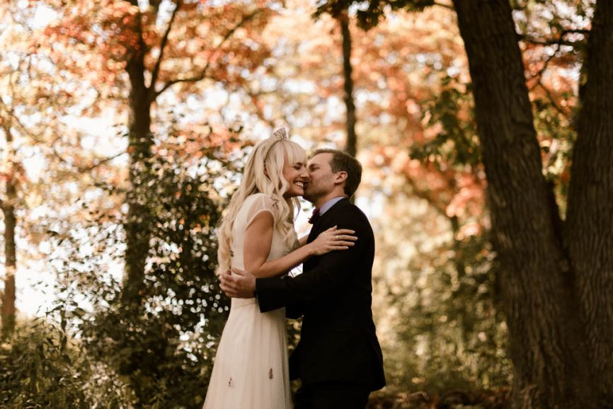 866x578px.groom_kissing_brides_cheek_first_look.jpg
