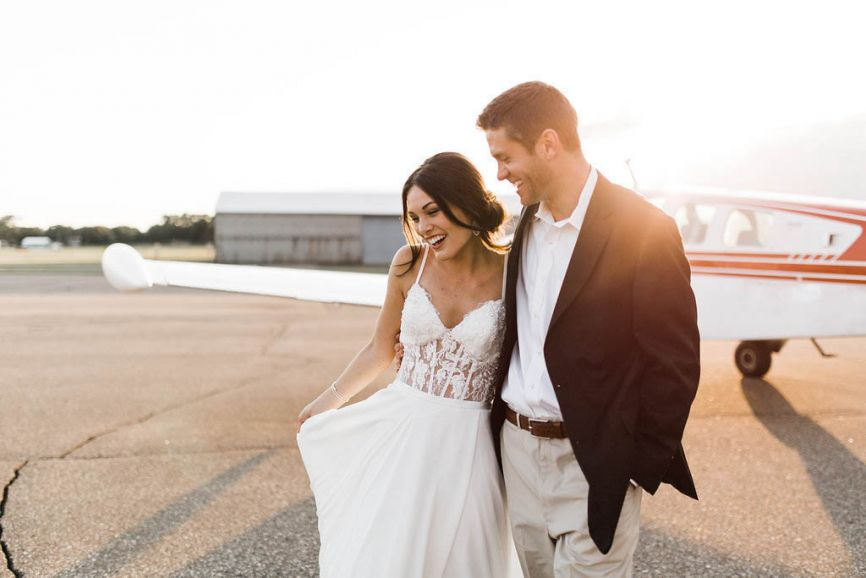 866x578px.lace_dress_bride_groom_smiling_golden_hour.jpg
