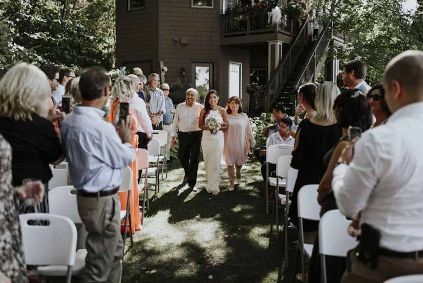 866x579px.bride_walking_down_aisle_backyard_wedding.jpg