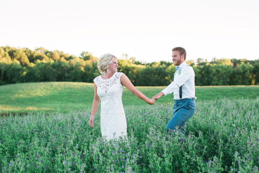 Bride_and_groom_field_golden_hour_photos_lace_bridal_dress.jpeg
