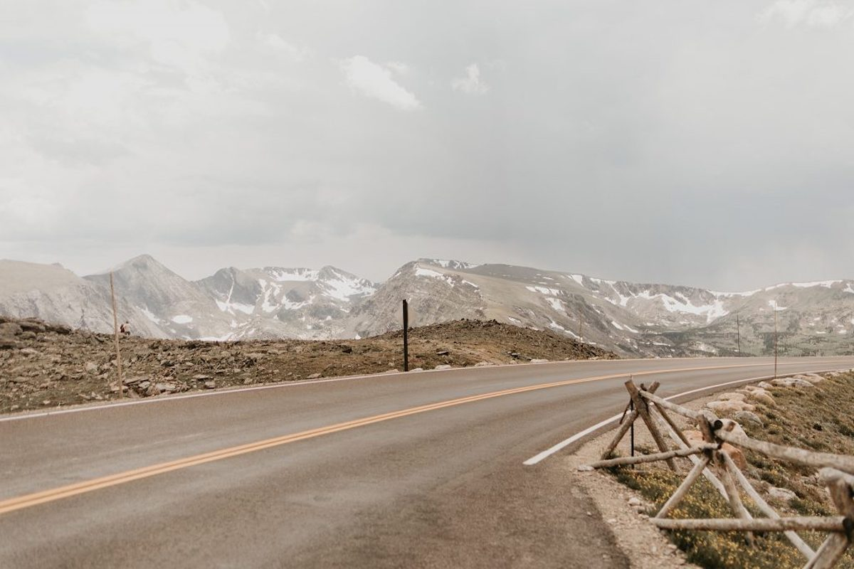 Colorado_state_park_view_of_road_mountain_background_cloudy_sky.jpg