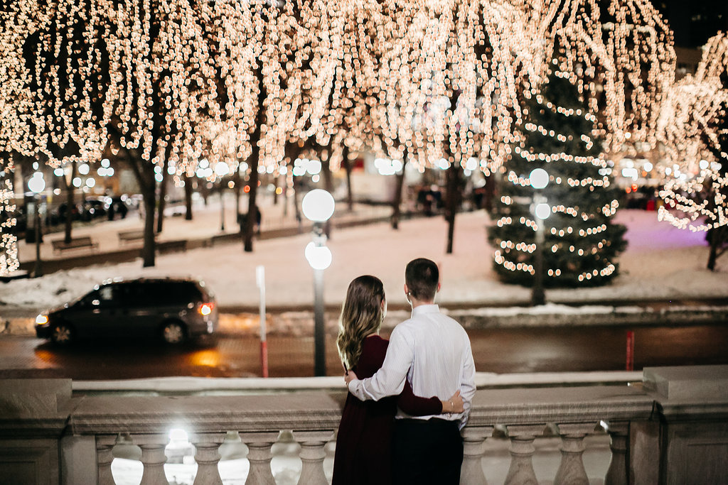Engaged_couple_look_over_at_Rice_Park.jpg