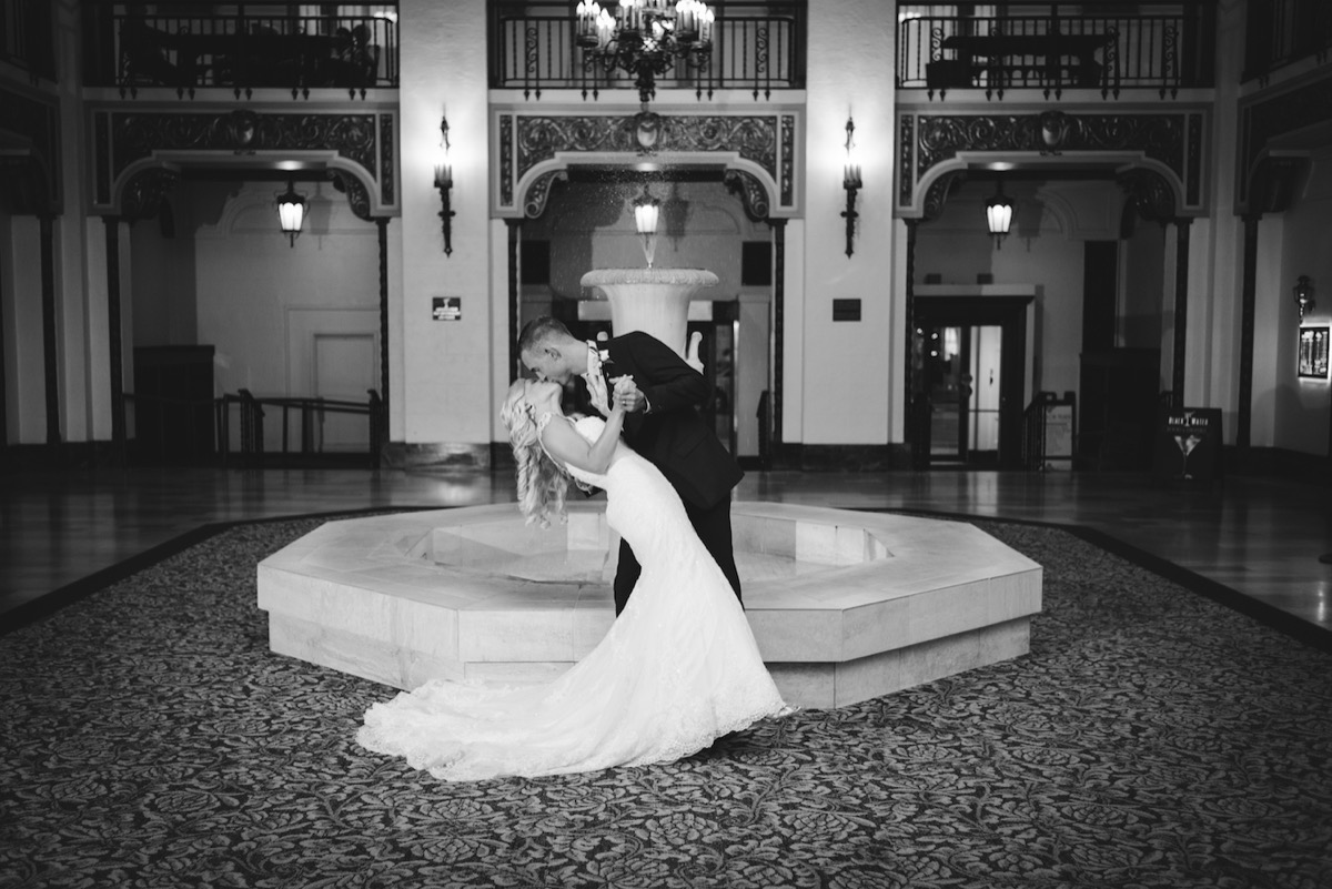 Greysolon_Ballroom_Moorish_Room_wedding_kiss_dip_by_fountain.jpg