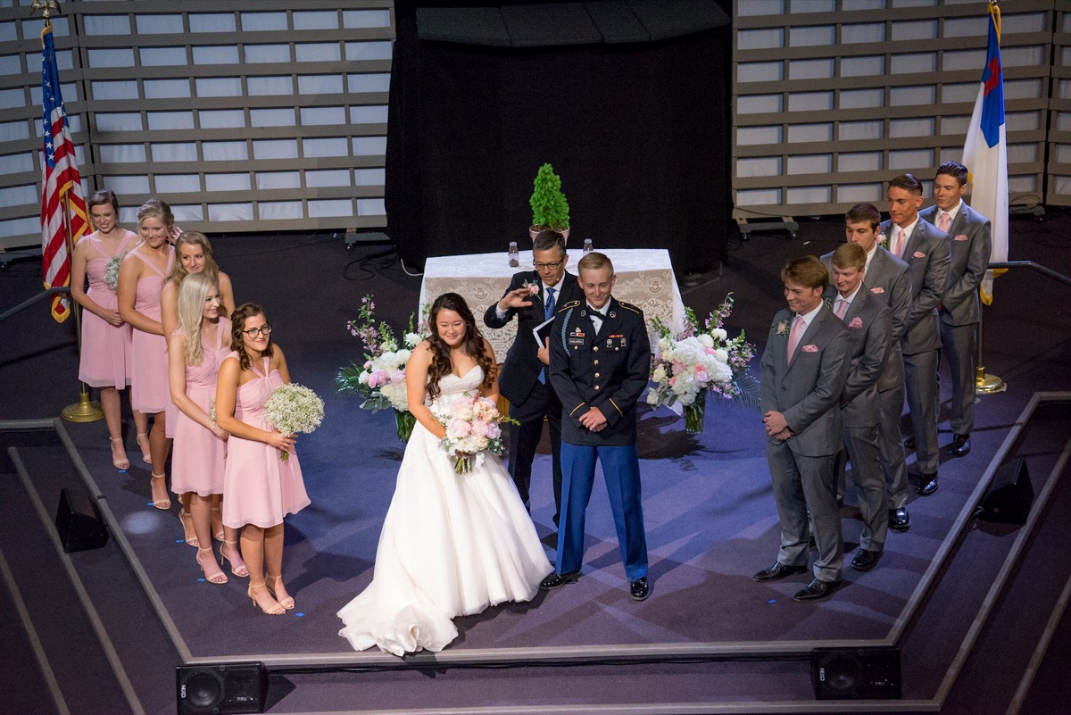 aerial_shot_of_bride_and_groom_being_announced_as_husband_and_wife.jpg