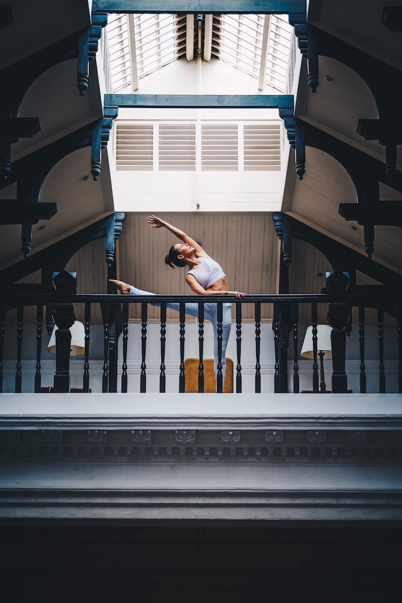 afternoon_stretch_woman_doing_yoga_on_indoor_balcony.jpg