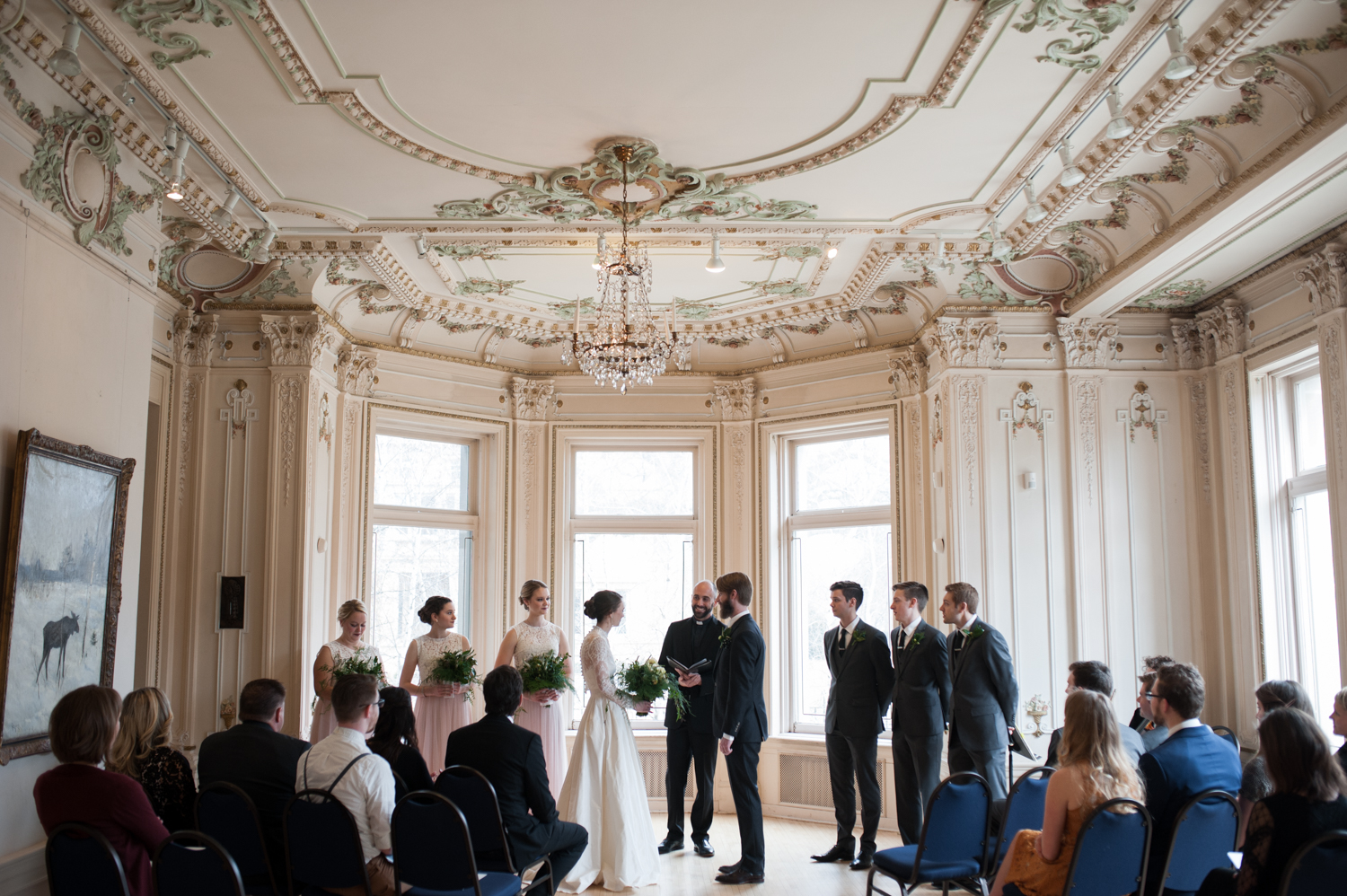 american_swedish_institute_wedding_large_windows_fancy_white_ceilings_with_gold_and_green_trim.jpeg
