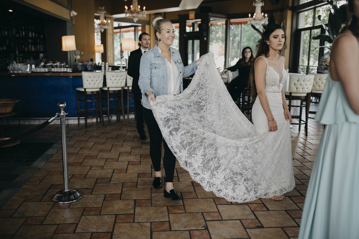 annika_bridal_boutique_consultant_carrying_bridal_gown_train.jpg