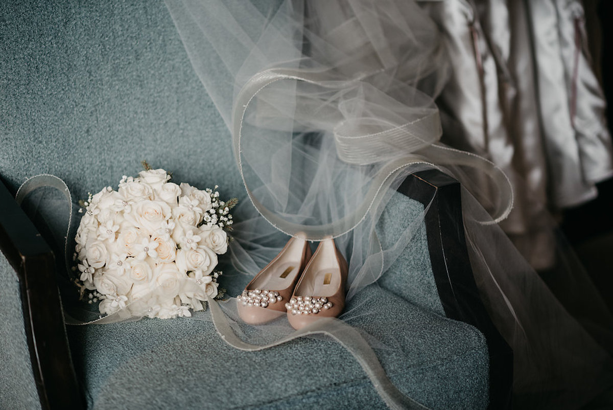 baby_blue_chair_with_wedding_veil_flats_and_white_bouquet.jpg