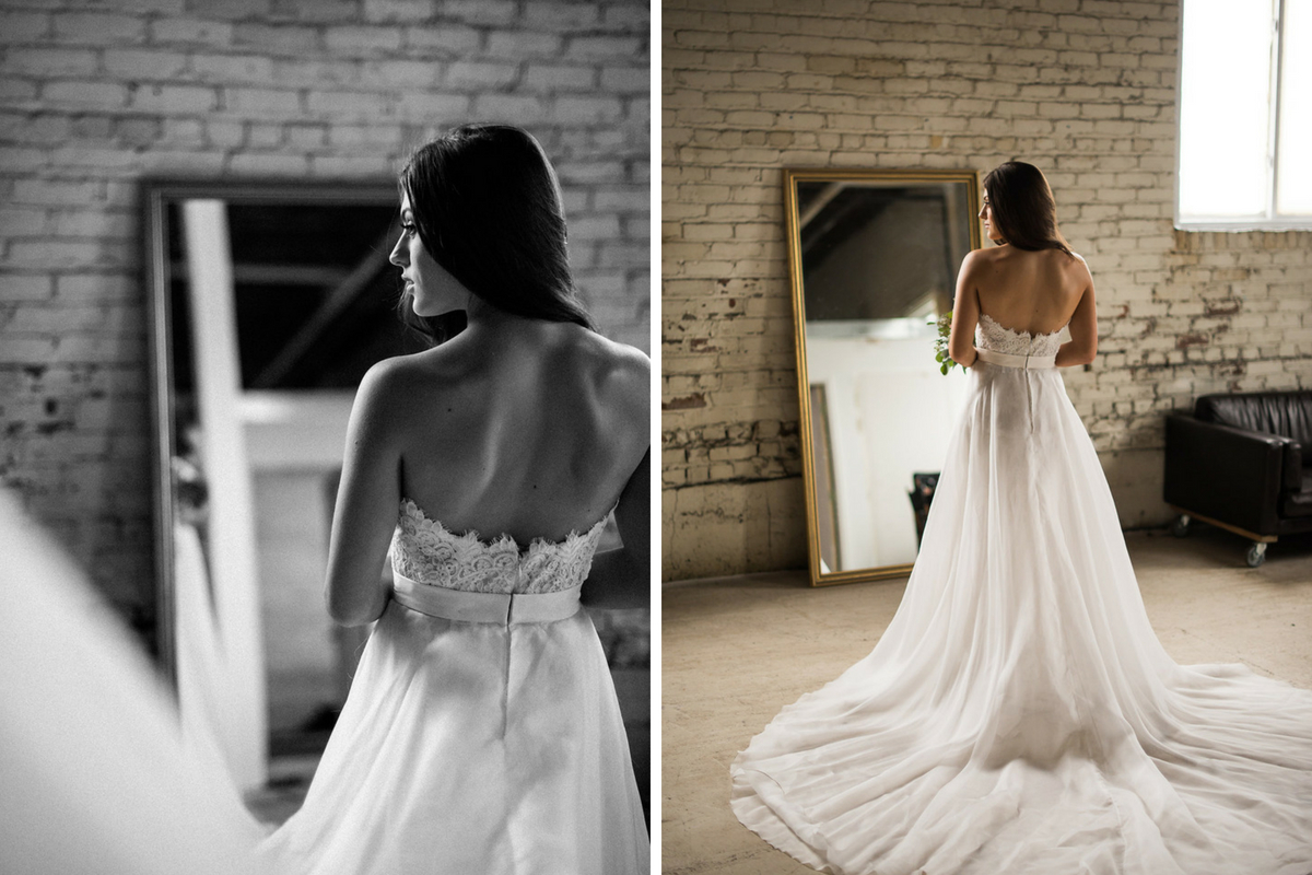 back_view_of_bride_in_gown_long_train_open_back_black_and_white_color.jpg