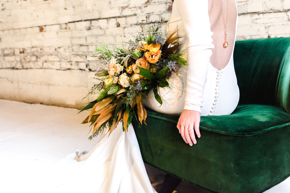 backless_wedding_dress_and_flowers.jpg