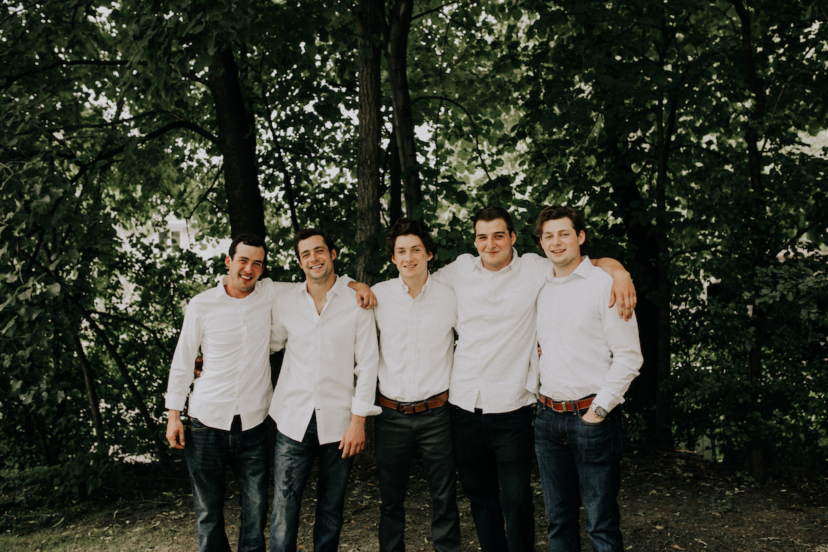 backyard_wedding_groom_and_groomsmen_white_shirts_jeans.jpg