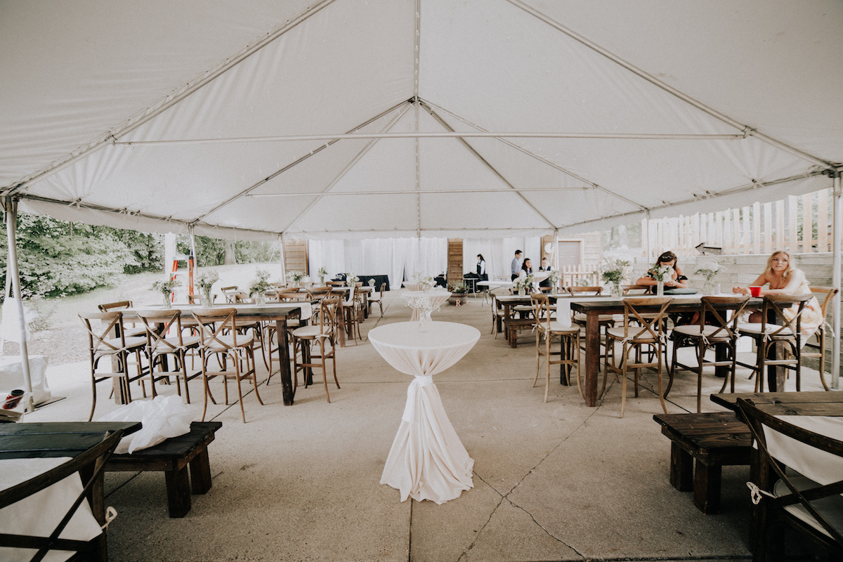 backyard_wedding_reception_white_tent_wood_tables.jpg