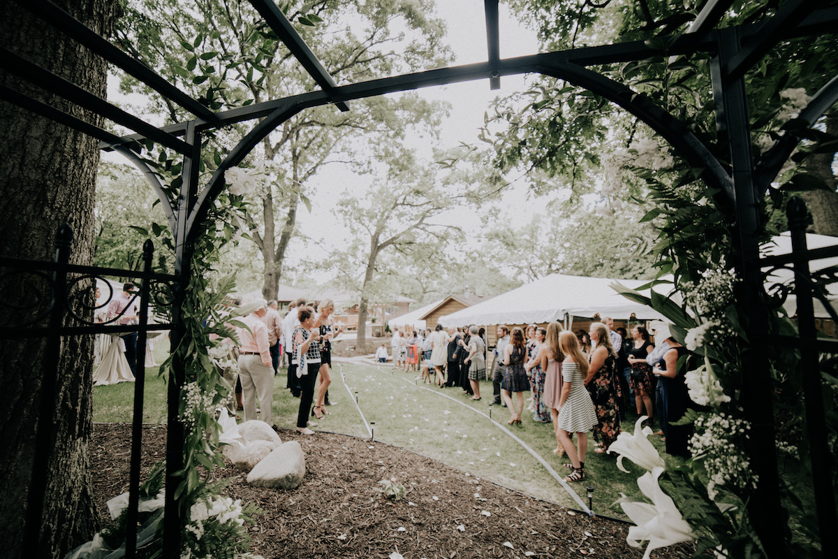 backyard_wedding_under_black_arch_with_flowers.jpg
