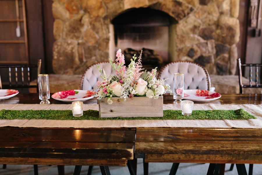 barn_wedding_reception_table_pink_white_wooden_flower_box_vintage_chairs_fireplace_.jpg