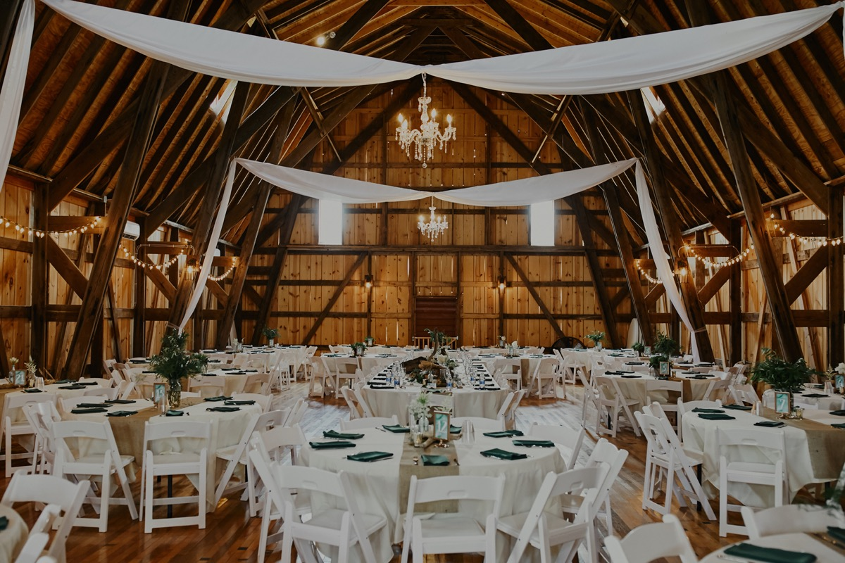 barn_wedding_reception_white_sheets_ceiling.JPG