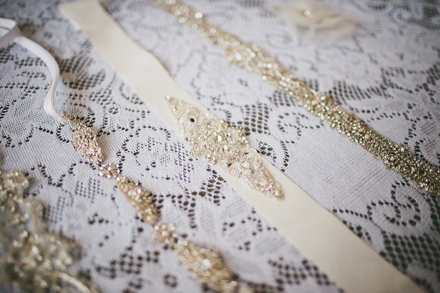 beaded_wedding_gown_accessories_on_lace_table_cloth.jpg