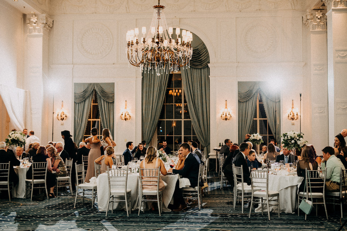 beautiful_white_wedding_reception-space_teal_curtains_gold_chandelier.jpg