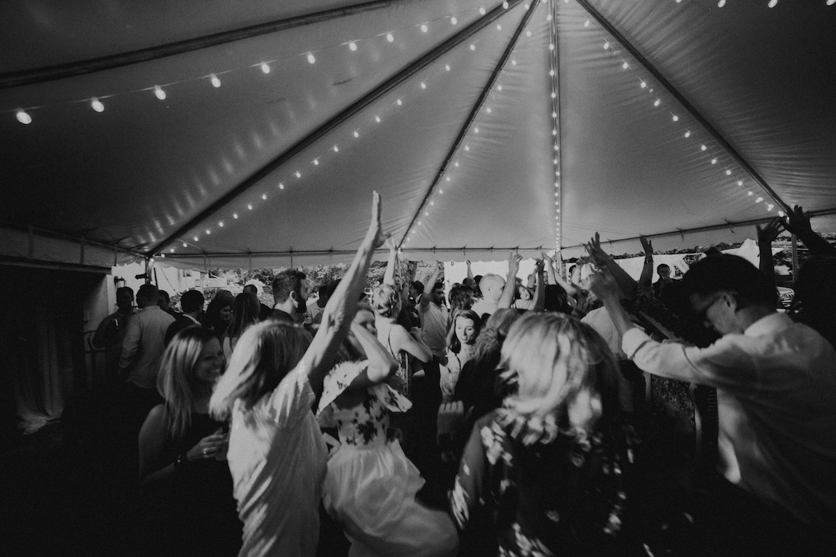 black_and_white_backyard_wedding_reception_dancing_under_tent.jpg