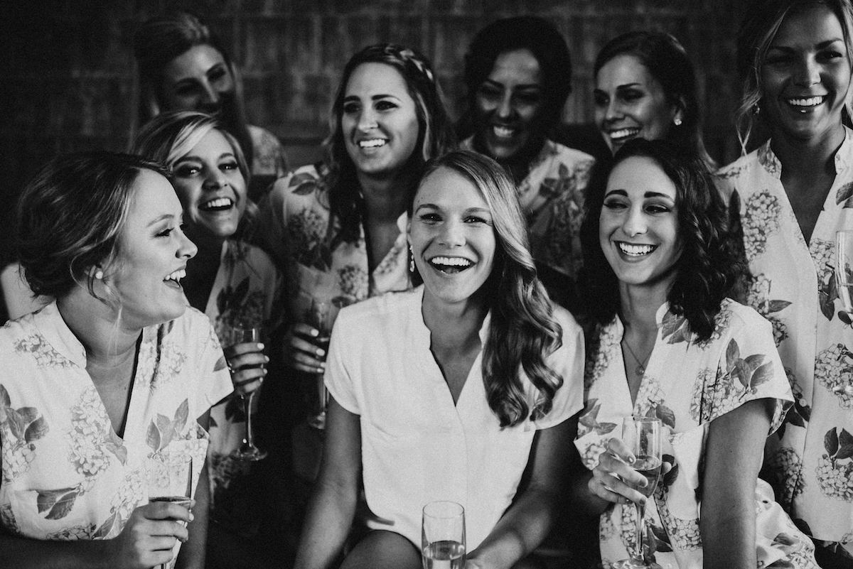 black_and_white_bridal_party_drinking_champagne_getting_ready_floral_pajamas.jpg