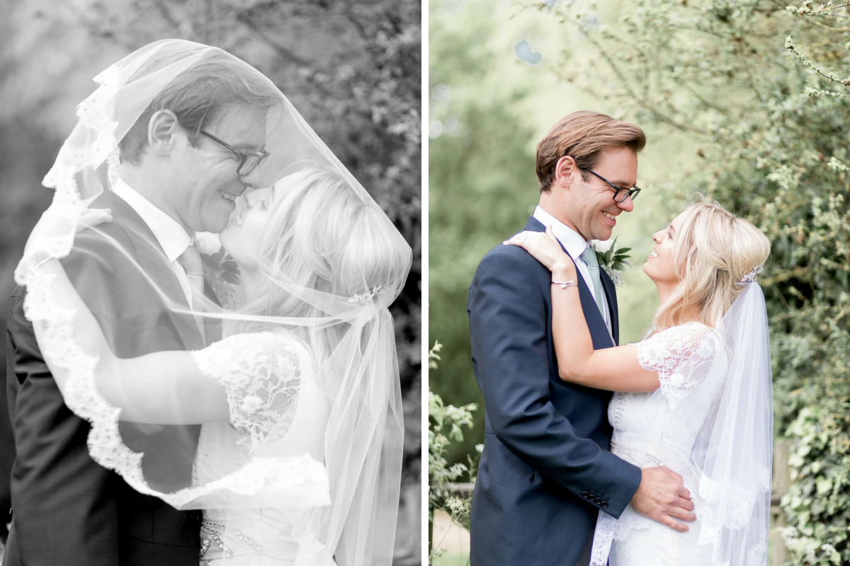 black_and_white_bride_and_groom_kissing_under_veil.jpg