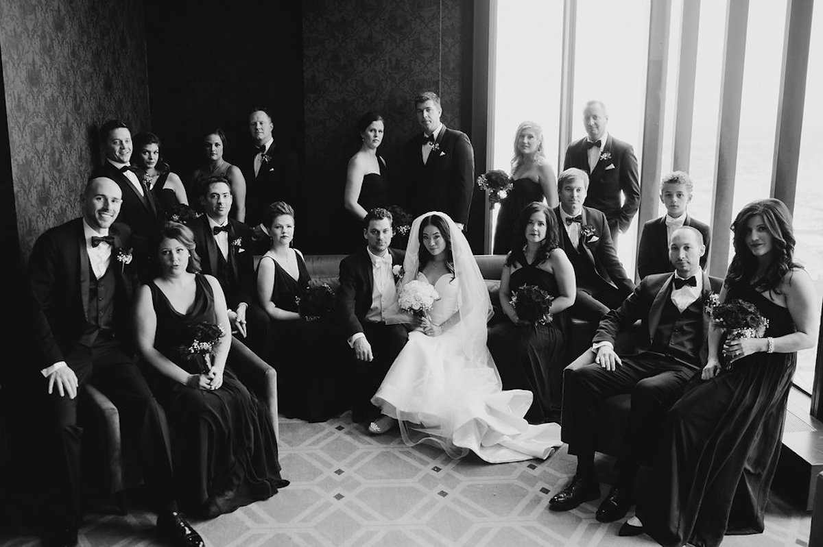 black_and_white_elegant_city_wedding_party_sitting_in_hotel_room.jpg