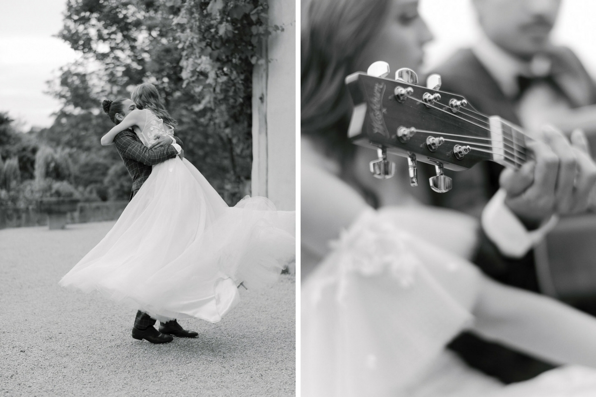 black_and_white_fench_bride_and_groom_twirling_outdoors.jpg