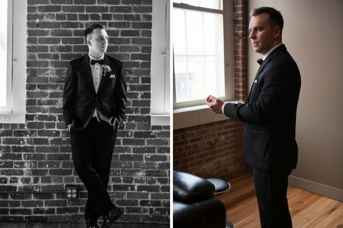 black_and_white_groom_leaning_against_brick_wall.jpg