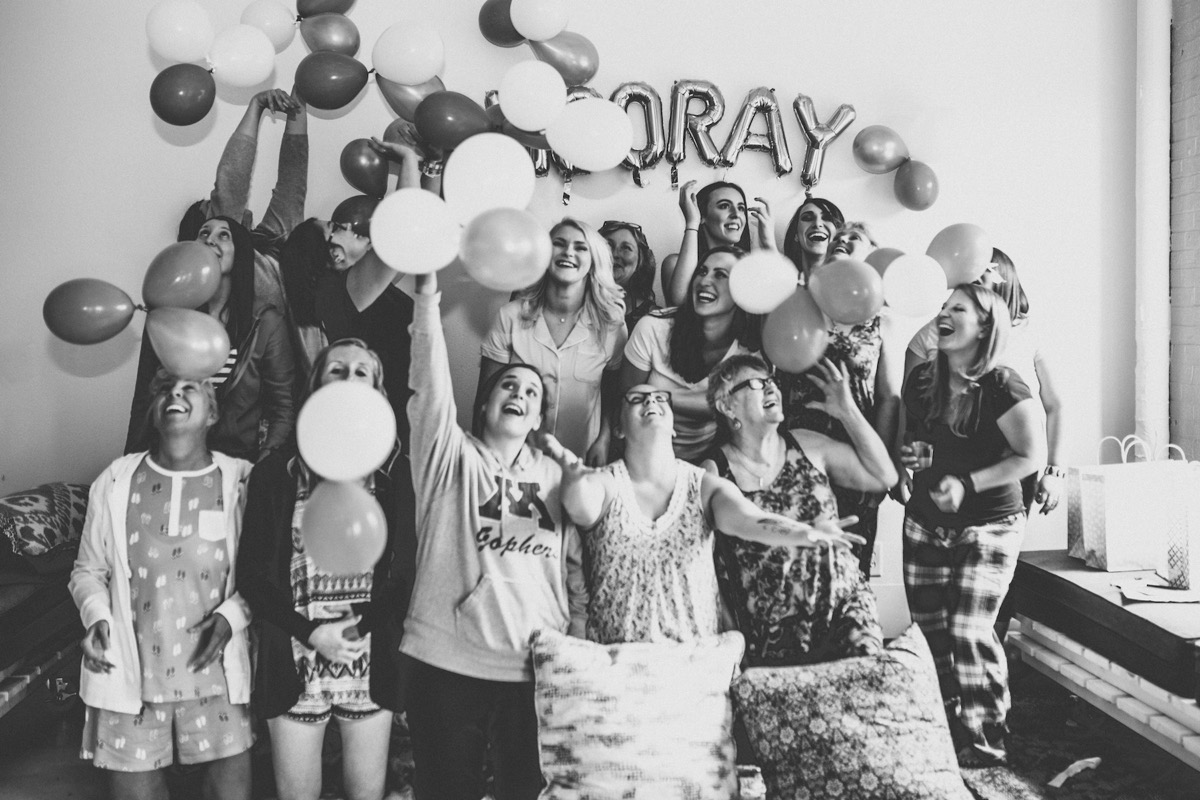 black_and_white_photo_bridal_shower_throwing_balloons_in_air.jpg