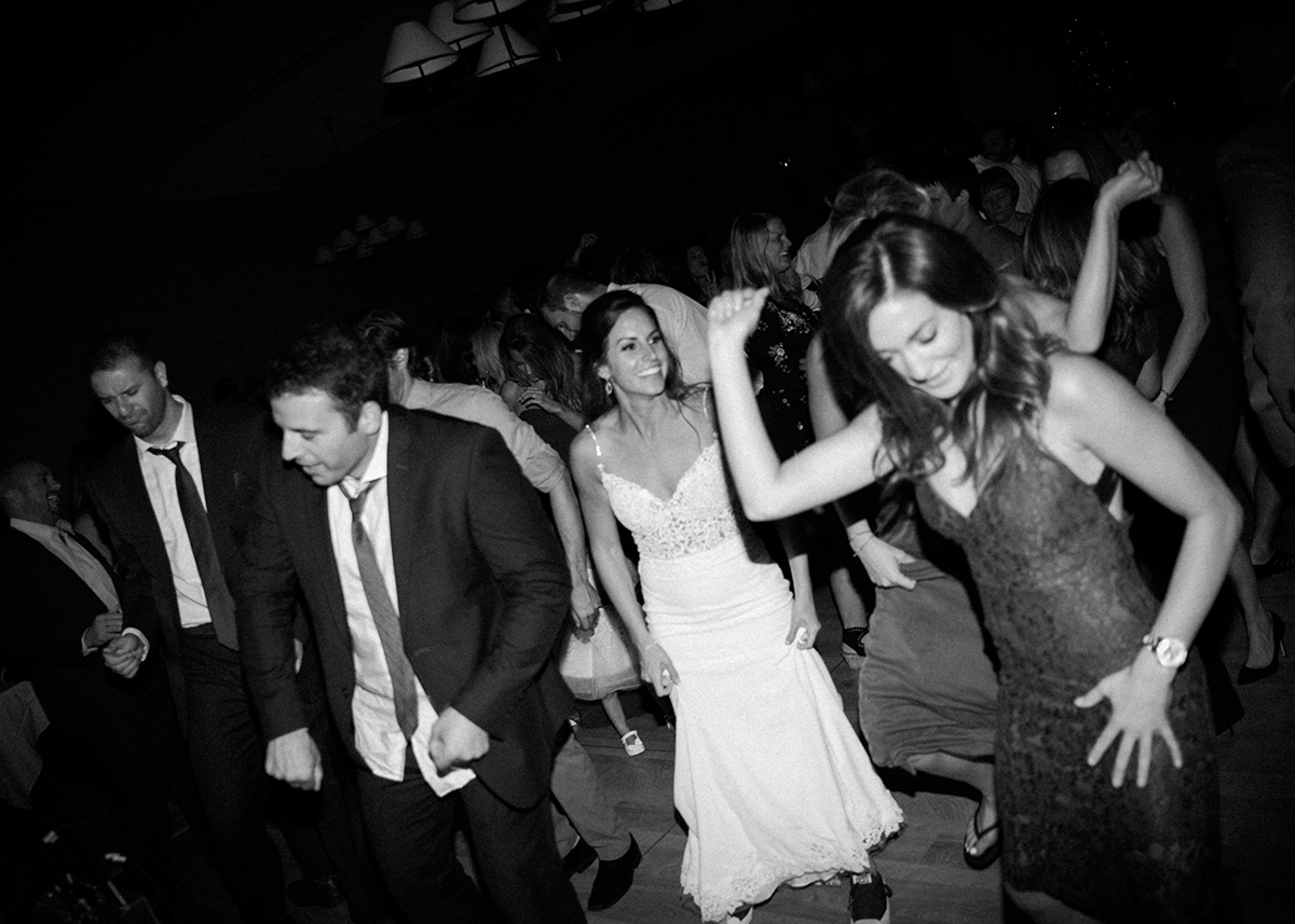 black_and_white_photo_bride_dancing_at_wedding_reception.jpg