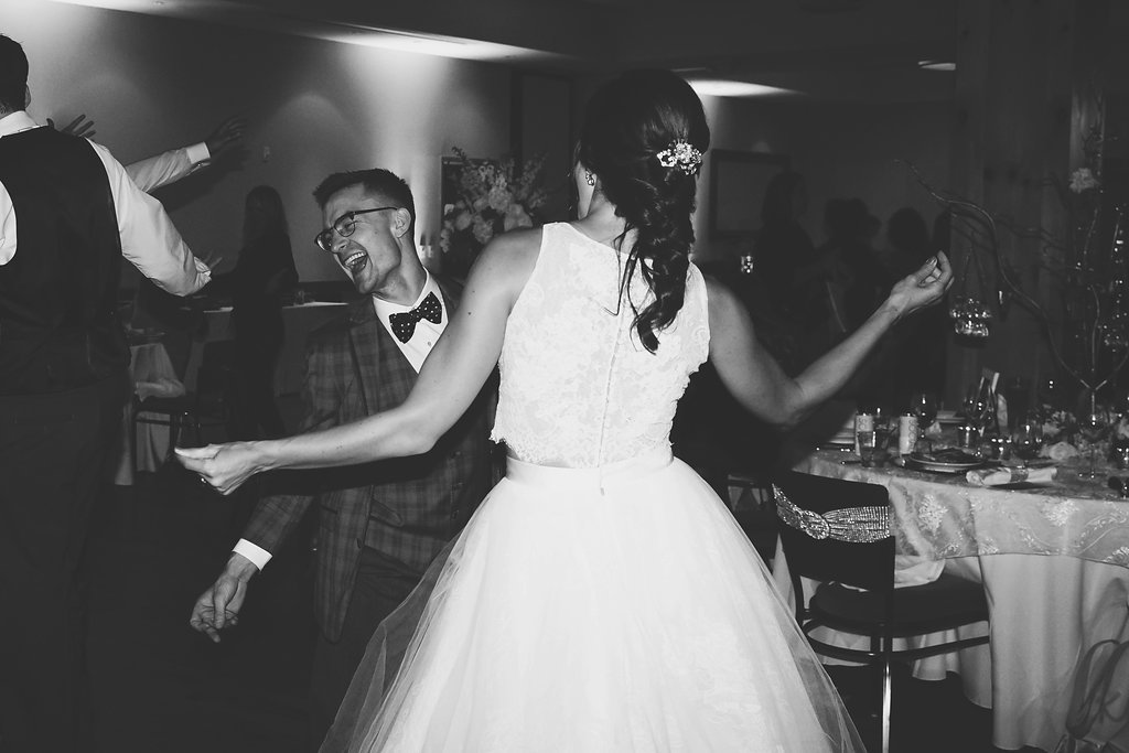 black_and_white_photo_bride_groom_dancing_wedding_reception.jpg