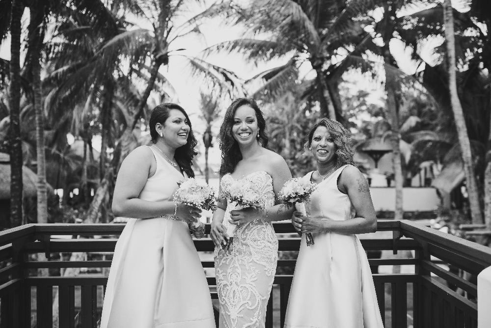 black_and_white_photo_bride_with_bridesmaids_smiling.jpg