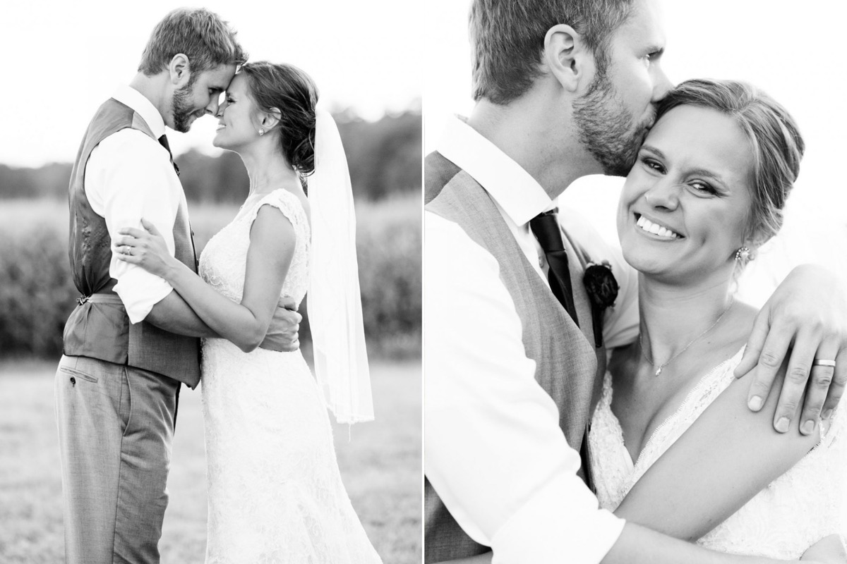 black_and_white_portrait_husband_and_wife_touching_foreheads_smiling.jpg