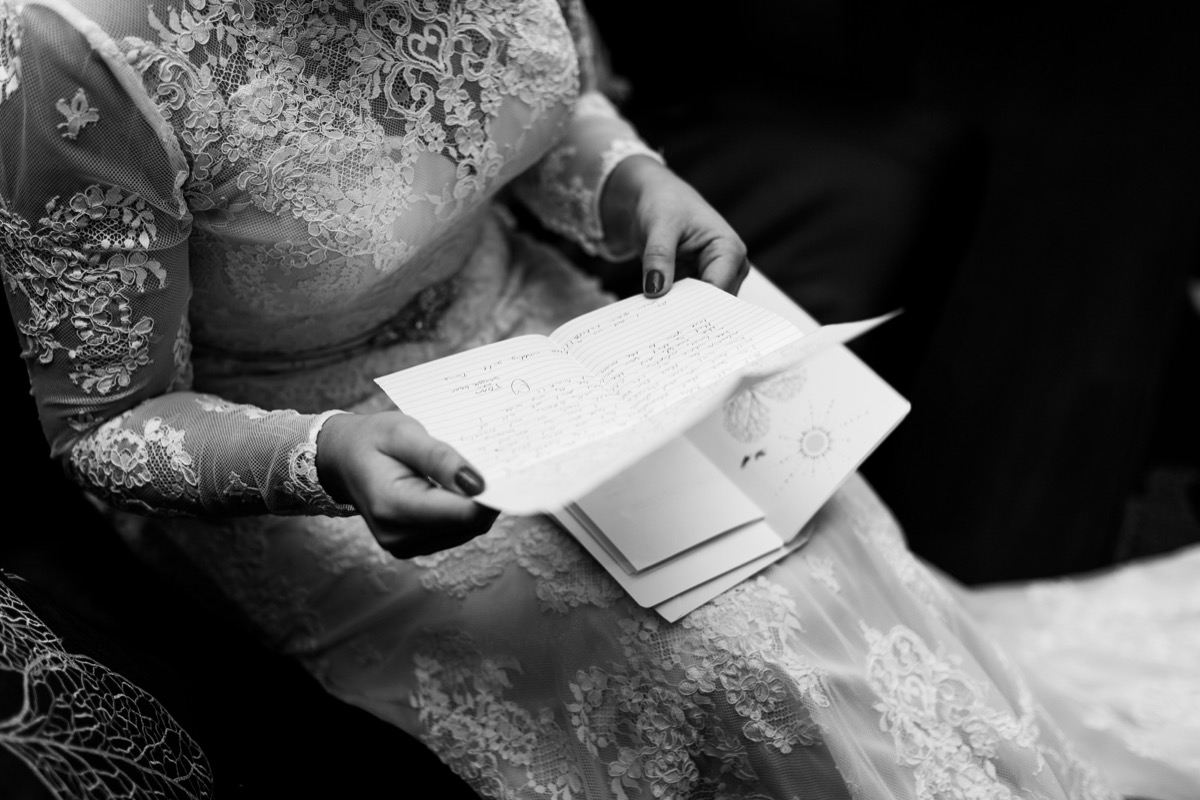 black_and_white_portrait_lace_gown_bride_reading_letter.jpg