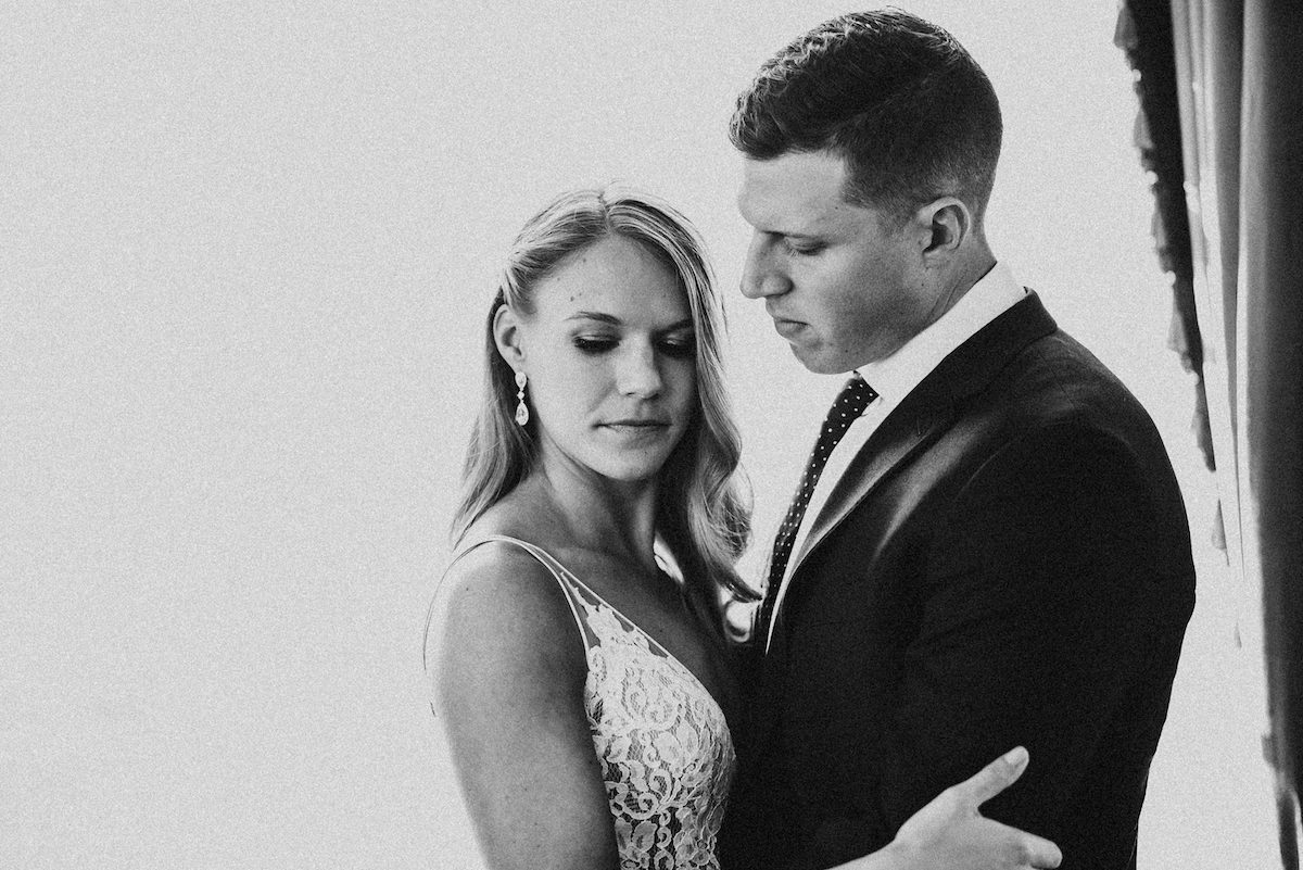 black_and_white_serious_bride_and_groom_holding_each_other.jpg