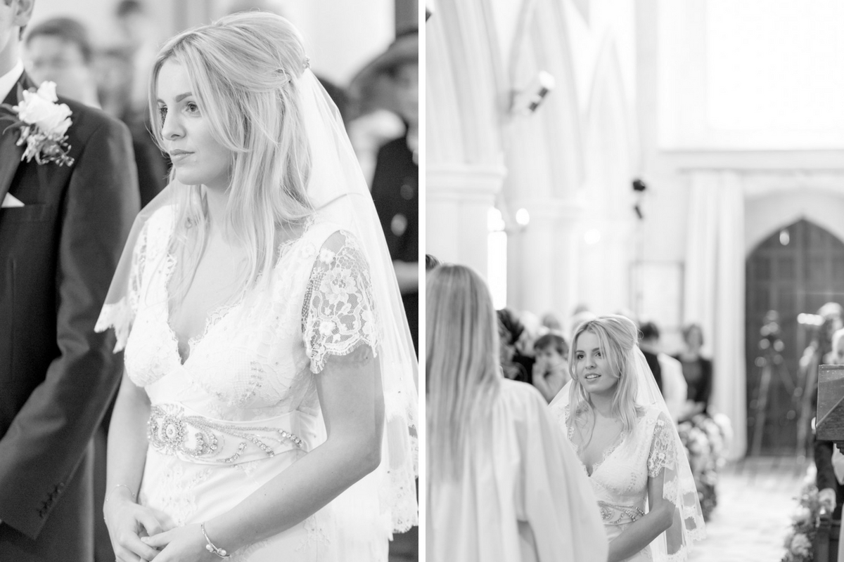 black_and_white_view_of_bride_during_church_wedding_ceremony.jpg