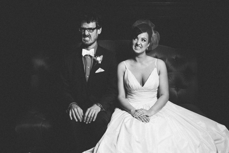 black_and_white_wedding_portrait_couple_making_funny_faces.jpg