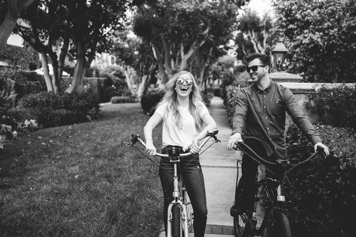 black_and_whtie_couple_riding_bike_in_california_neighborhood.JPG