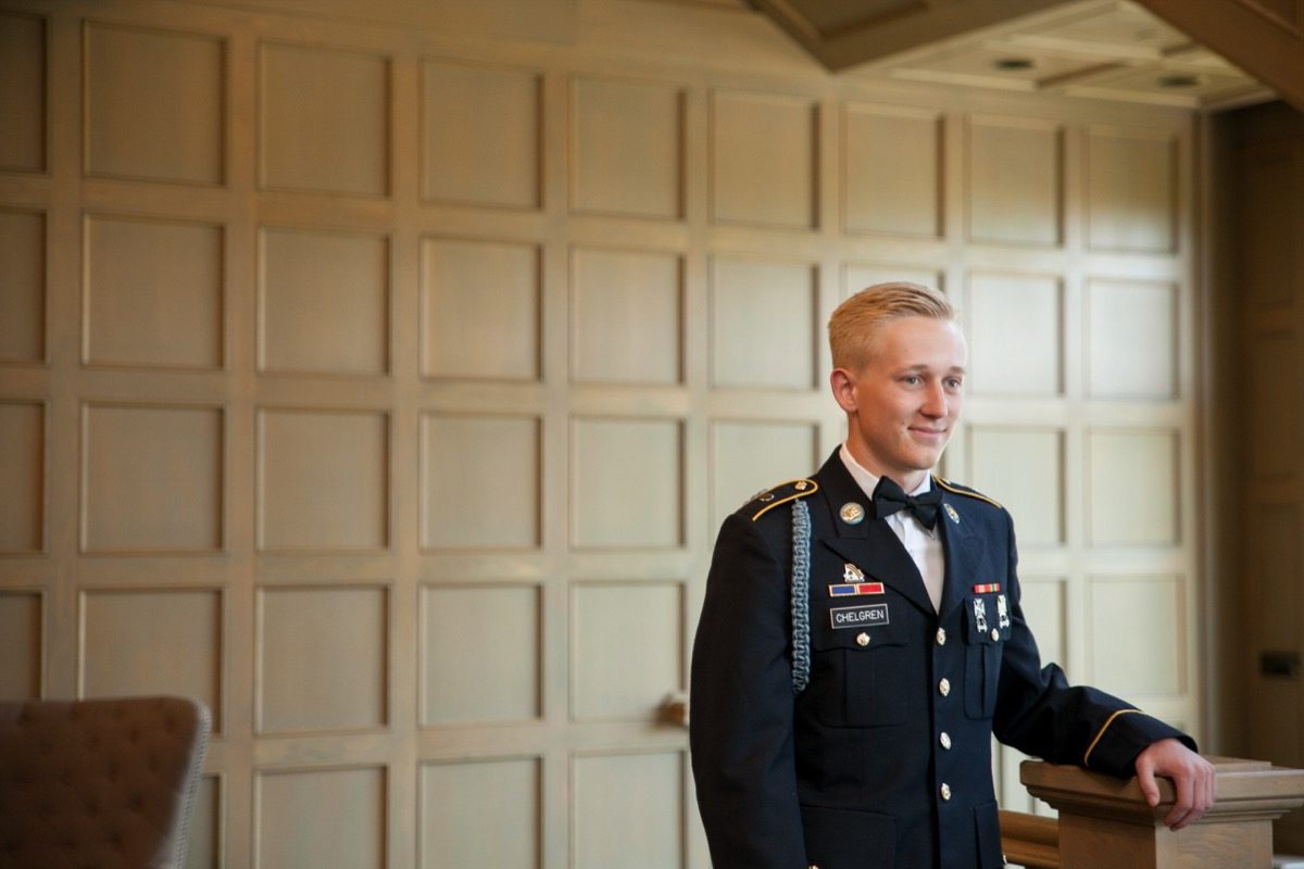 blonde_groom_navy_military_outfit_smiling_at_bride.jpg