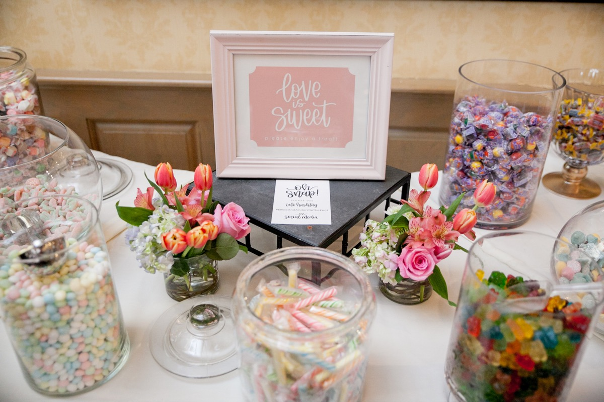 blush_love_is_sweet_sign_white_calligraphy_candy_table.jpg