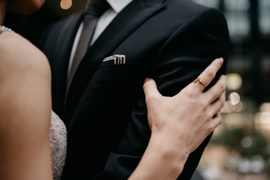body_shot_of_bride_putting_hands_on_grooms_arms.jpg