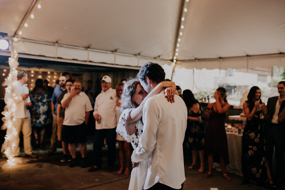 boho_bride_and_groom_dancing_in_white_tent_backyard_wedding.jpg