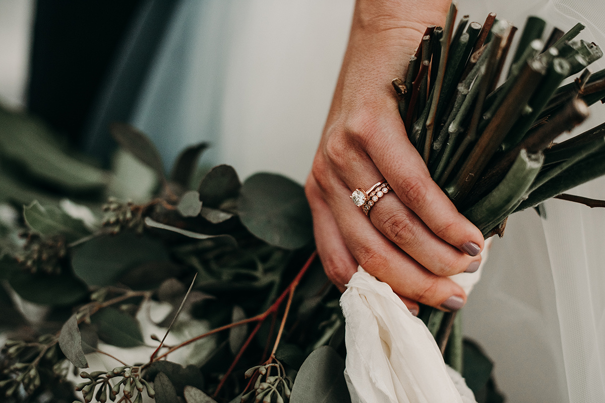 boho_bride_holding_flowers_close_up_ring.jpg