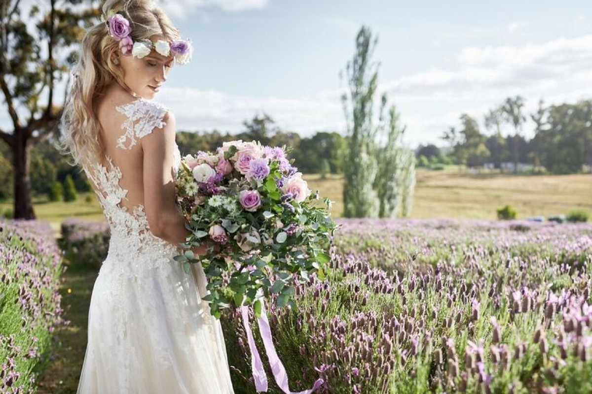 boho_bride_in_field_of_purple_flowers.jpg