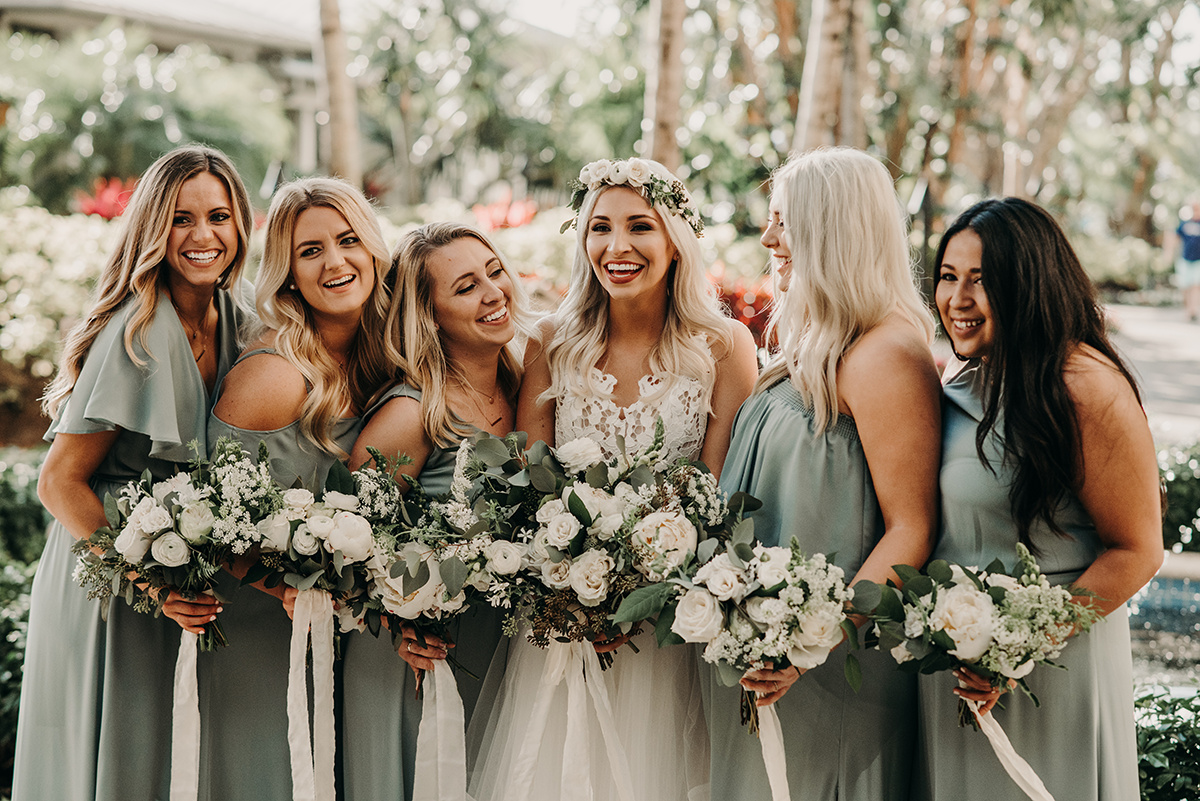 boho_bride_smiling_with_bridesmaids_seafoam_green_dresses.jpg