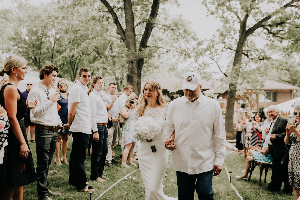 boho_bride_walking_down_aisle_with_dad_crying.jpg