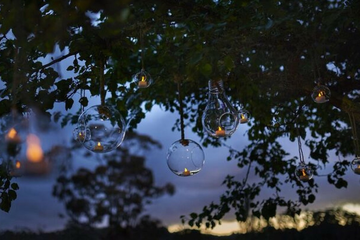 boho_wedding_bulbs_hanging_from_tree.jpg