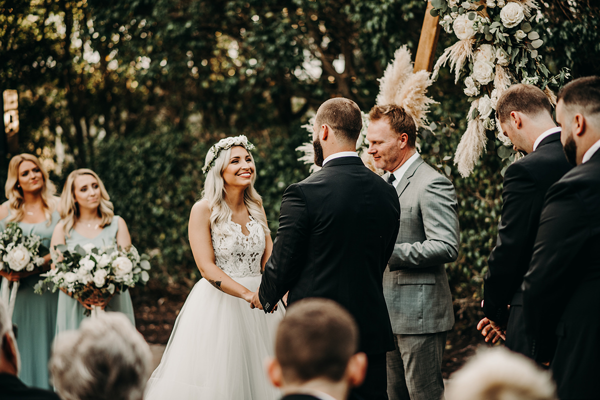 boho_wedding_ceremony_bride_smiling_at_groom.jpg