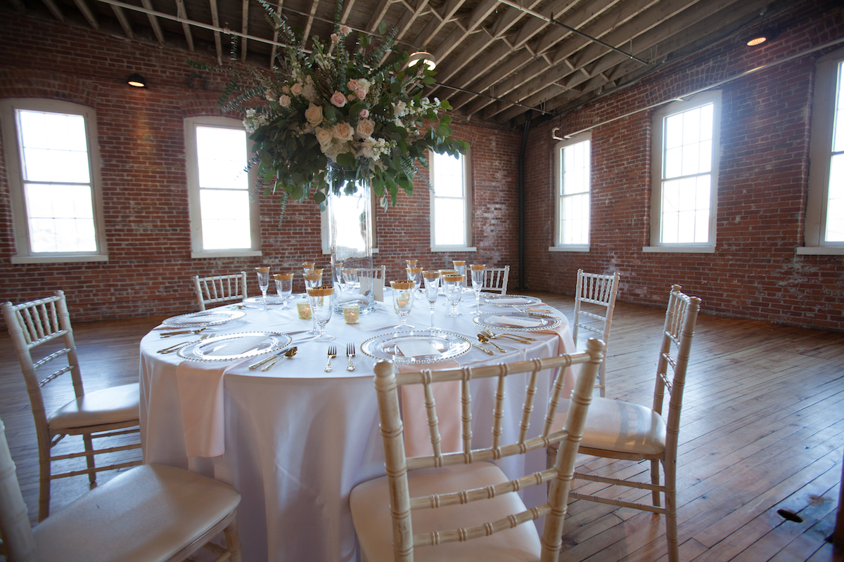 brick_industrial_building_white_gold_wedding_dinner_table_large_centerpiece.jpg